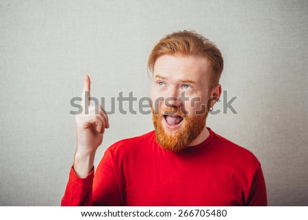Eureka. man with an idea raising his finger in the air - stock photo