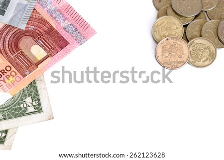 Euro and Dollar against Russian Ruble coins on white background. Money from different countries - stock photo
