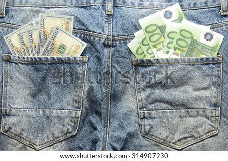 Euro and Dollar banknotes in jeans back pockets - stock photo