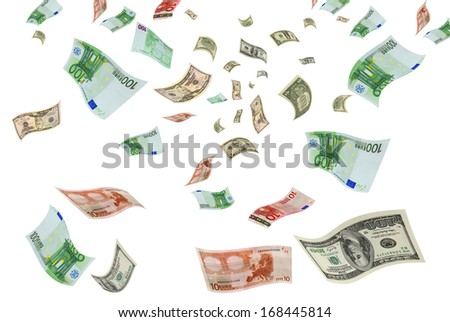 Euro and dollar bills are flying on a white background. - stock photo