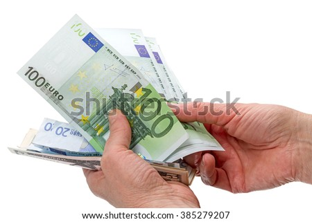 Euro and dollars in the hands of women. Isolated on white background