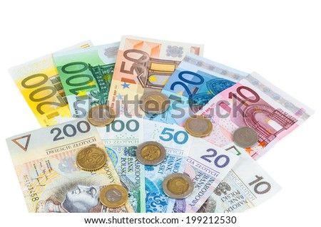 Euro and new polish zloty banknotes with coins isolated on white background with clipping path