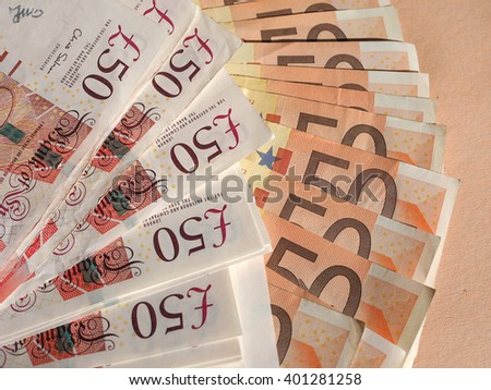 Euro and Pounds banknotes currency of European Union and United Kingdom - stock photo