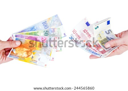 euro and Swiss franc in the hands of - stock photo