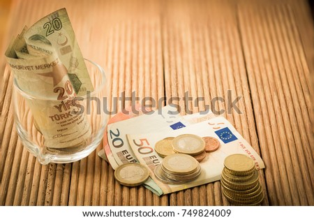 Euro And Turkish Lira Banknote And Coins On Brown Wooden Plank Use As Business