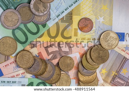 euro banknote and euro coin