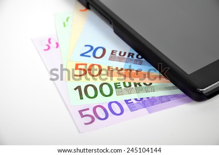euro banknote and modern cellphone, close up - stock photo