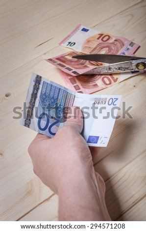 Euro banknote in hand