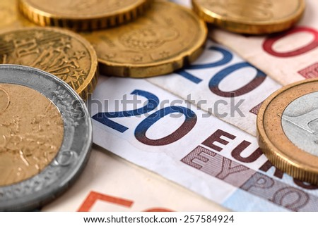 euro banknote money and coins, close up