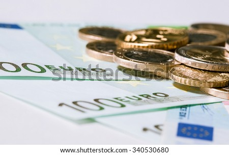 Euro banknotes and coins on neutral background - stock photo