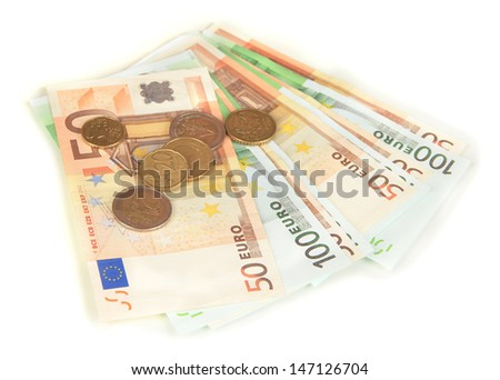 Euro banknotes and euro cents isolated on white - stock photo