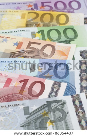 Euro banknotes, close-up with shallow depth-of-field; focus on the 20 Euro banknote - stock photo