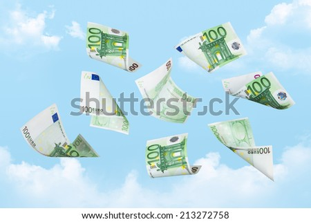 Euro banknotes falling down on cloudy sky background. - stock photo