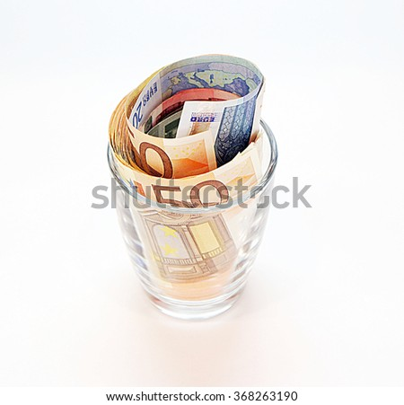 Euro banknotes in a glass - stock photo