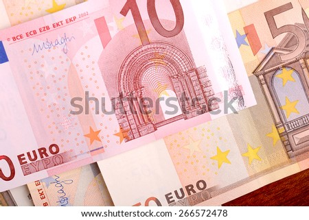 euro banknotes in a row. European Union Currency. Stack of 50 euro banknotes - stock photo