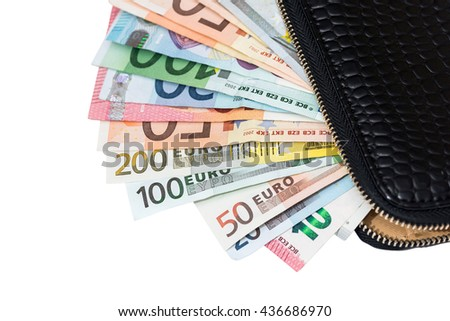 euro banknotes in leather black purse isolated on white background