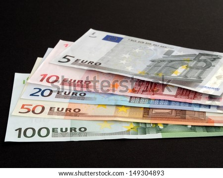 Euro banknotes isolated on black background