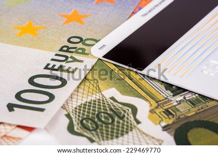 Euro banknotes of one hundred and credit card with magnetic stripe - stock photo