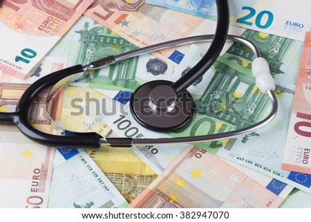 euro banknotes of various denominations with stethoscope