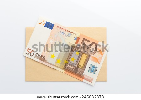 Euro banknotes on envelope white background  - stock photo