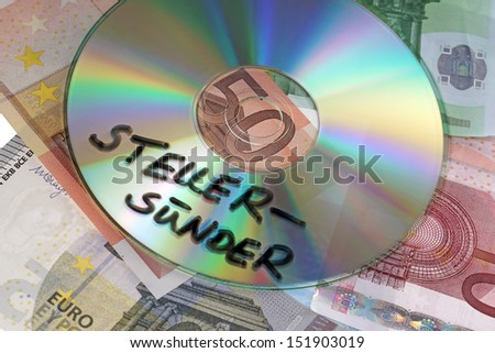 Euro banknotes with CD and the german words tax evader / tax evader