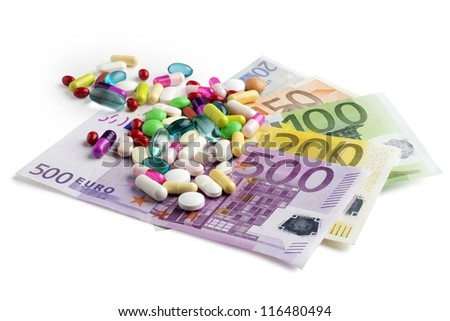 euro banknotes with colorful medicines on white background - stock photo