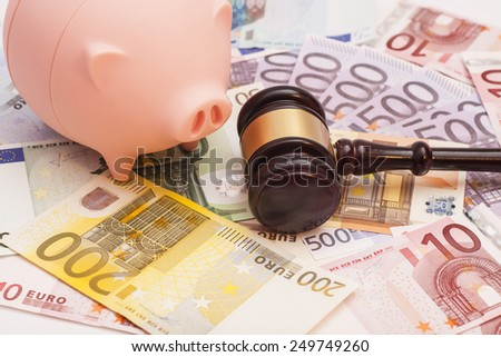 Euro banknotes with court gavel and piggy bank - stock photo