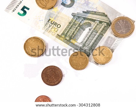 euro bill and coin lay over the european union map. business symbol for wealth and gain, over white - stock photo