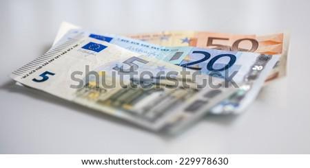 Euro billets, total of 75 euro - stock photo