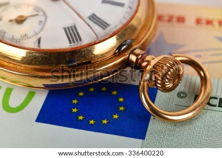 Euro bills and golden pocket watch, close up - stock photo