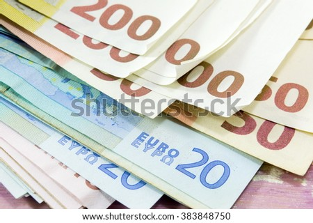 Euro bills stacked  on the wooden table