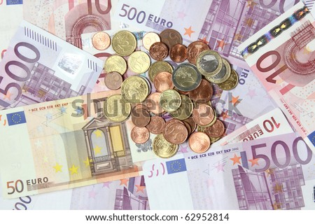 Euro bils with coins