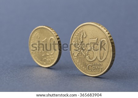 euro cent coins on blue background - stock photo