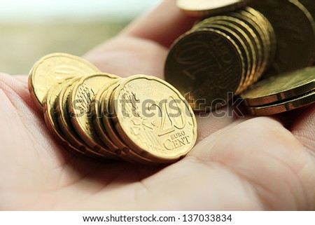 Euro cents in hand. Macro image. - stock photo