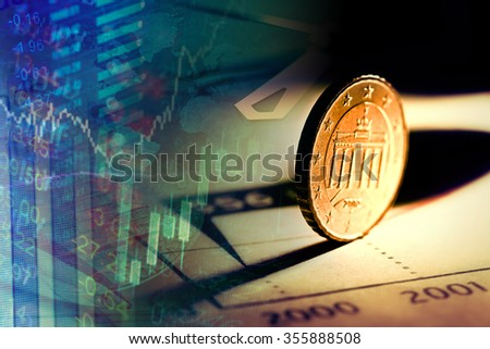 Euro coin on a graph. Financial up and down trand. - stock photo