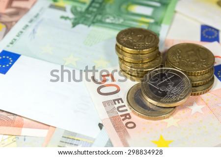 euro coin on euro background - stock photo