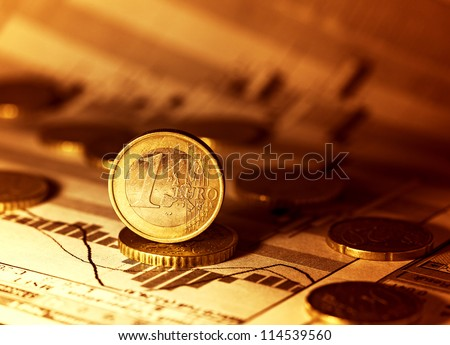 Euro coin on stock chart. Selective focus. - stock photo