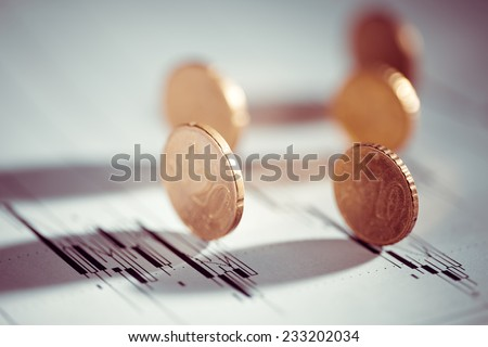 Euro coin on stock chart. Selective focus. - stock photo