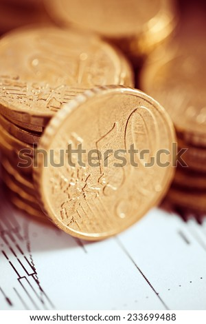 Euro coin on stock chart. Selective focus. Macro image.
