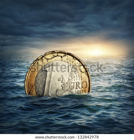 Euro coin sinking in water. Euro crisis concept. - stock photo