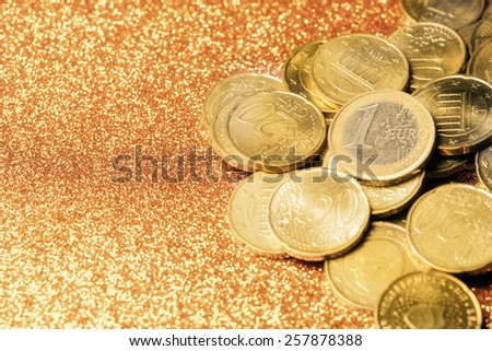 Euro coin stack over yellow abstract background - stock photo