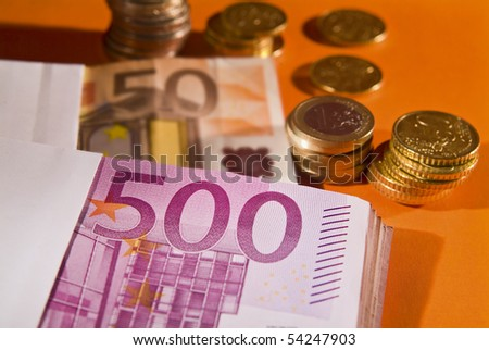 Euro coins and banknote