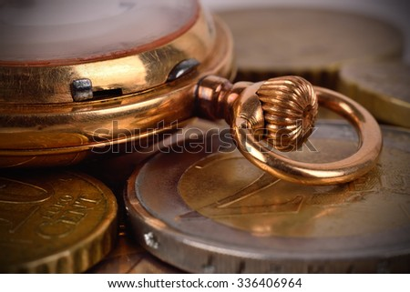 Euro coins and golden pocket watch, close up - stock photo