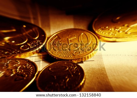 Euro coins and us dollar banknote background. Pincushion lens use. - stock photo