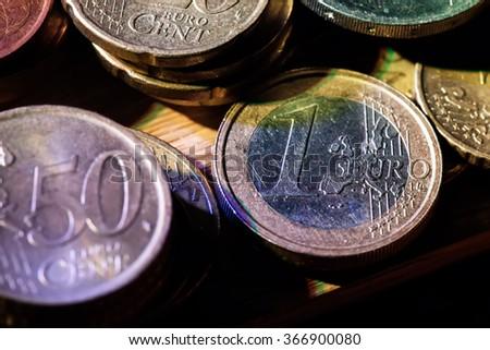 euro coins columns with a deep dark shadows - stock photo