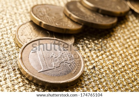 Euro coins currency of the European union over golden surface