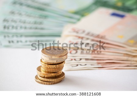 Euro coins. Euro money. Coins stacked on each other in different positions. - stock photo