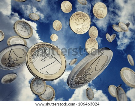 euro coins falling from sky - stock photo