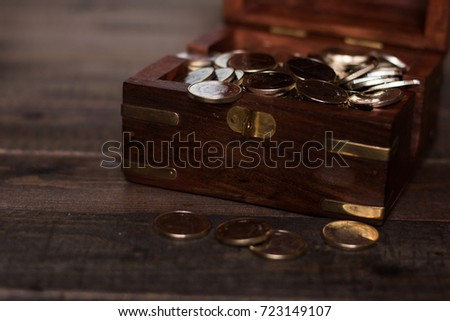 Euro coins in a chest