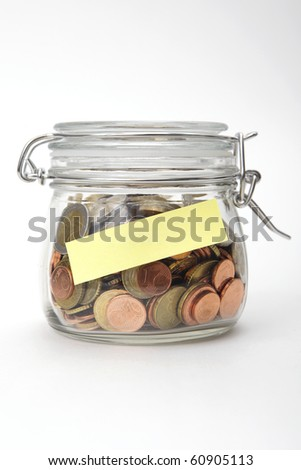 Euro coins in a glass jar with blank label on white background - stock photo